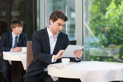 While drinking coffee in café Stock Photography