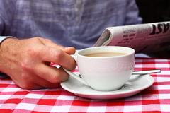 Drinking coffee at cafe B. Photograph of a man drinking coffee outdoor Stock Images