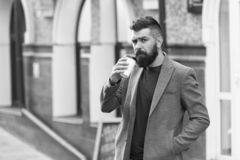 Drinking coffee on the go. Businessman lumbersexual appearance enjoy coffee break out of business center. Relax and. Recharge. Man bearded hipster drinking stock photo