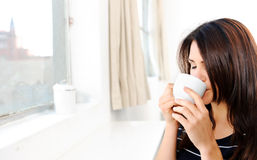 Drinking coffee at home Royalty Free Stock Image
