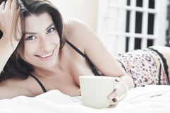 Drinking coffee in lingerie Stock Image