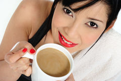 Drinking coffee with milk  after practicing sport Royalty Free Stock Images