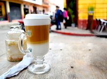 Drinking coffee outside in the city stock photo