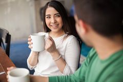 Drinking coffee with my girlfriend. Point of view of a young men enjoying some coffee with his girlfriend in a cafe Royalty Free Stock Photography