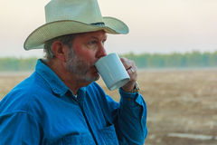 Drinking coffee. Senior cowboy drinking coffee in morning Royalty Free Stock Photo