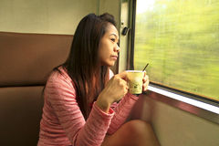 She drinking coffee in the train Stock Image