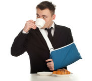 Drinking coffee young businessman with broken hand Royalty Free Stock Photos