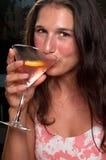 Drinking a cosmopolitan Royalty Free Stock Image