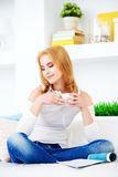 Drinking a cup of coffee Royalty Free Stock Photography