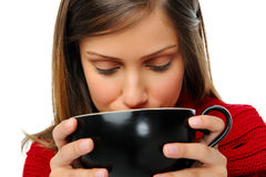 Drinking a cup of soup Stock Image