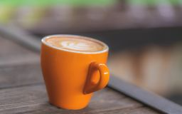 Hot Latte Coffee In Orange Cup stock photo