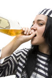 Drinking Detainee. Lifts Her Spirits While Doing Time And A Bottle Of Scotch Royalty Free Stock Photos