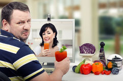 Drinking the detox juice with great reluctance Stock Image