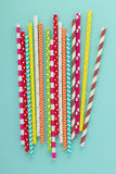 Drinking disposable straws for beverage on cyan background. Stock Image