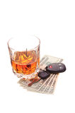 Drinking and driving. Glass of alcohol, keys, and money Stock Images