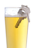 Drinking and driving. Keys on a glass of beer Stock Photography