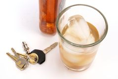 Drinking and Driving. Alcohol concept with glass of whiskey next to car keys on white table. Deep depth Stock Images