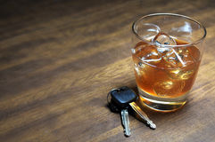 Drinking and Driving. Glass of whiskey and car keys on wooden table Royalty Free Stock Photo