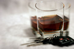Drinking & Driving - Blurry Vision. A set of car keys and a glass of liquor with a blurred triple-vision effect from drinking too much royalty free stock photo