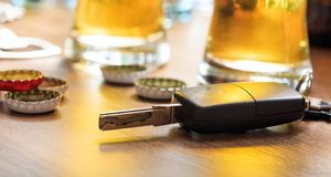 Drinking and driving. Car key on a wooden bar counter Royalty Free Stock Photo