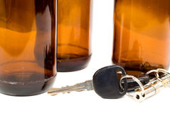 Drinking And Driving Concept. Concept image of drinking and driving with a shot of some car keys beside some empty beer bottles Royalty Free Stock Photography
