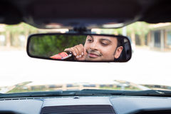 Drinking, driving, reflecting. Closeup portrait, young guy drinking alcoholic beverage stoned, under the influence,  isolated interior car windshield background Stock Photo