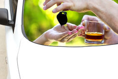 Drinking and driving in traffic Royalty Free Stock Image