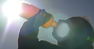 Drinking energy sports hydration drink from plastic bottle adult model