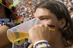 Drinking fan. Drinking german fan Stock Images