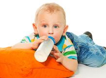 Drinking formula from bottle Royalty Free Stock Images