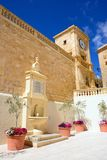 Drinking fountain and bell tower, Victoria, Gozo. Royalty Free Stock Image