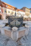Drinking fountain on the central square of the Romanian Brasov stock images