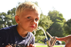 Drinking Fountain Chid. A child at a water fountain outside Royalty Free Stock Photos