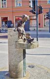 Drinking fountain decorated by sculptures of kids and a catfish on central Piotrkowska Street Stock Photo