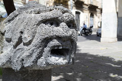 Drinking fountain. Face shaped drinking fountain with running water Royalty Free Stock Images