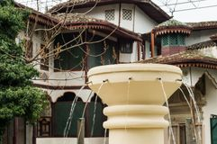 Drinking fountain in Khans Palace. Plants on tiled roof of palace. Life on old roof. Khans palace . royalty free stock photography