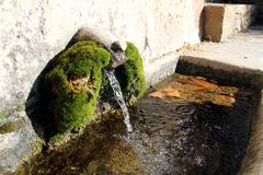 A drinking fountain in the little town of Seva Royalty Free Stock Photo