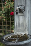 Drinking fountain. Recorded in botanical garden in Augsburg, Germany Stock Images