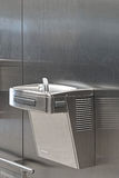 Drinking fountain. Stainless steel drinking fountain mounted at wall Royalty Free Stock Photo