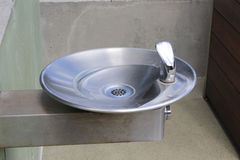 Drinking fountain. Stainless steel drinking fountain in the park Stock Photo
