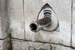 Drinking fountain with stream of water Royalty Free Stock Image