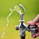 Drinking Fountain with Water Flowing Royalty Free Stock Photos