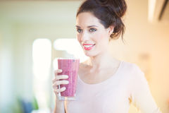 Drinking Fresh Berry Smoothie Stock Images