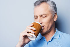 Drinking fresh coffee. Royalty Free Stock Images