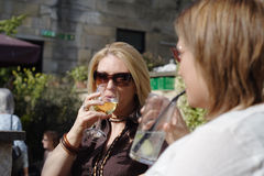 Drinking with friends. Enjoying a glass of wine in the beer garden with friends stock photography