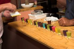 Drinking games. In a bar with colourful shooters Stock Photos