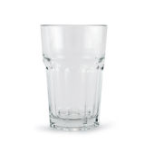 Drinking glass cup over white background. Faceted drinking empty glass cup isolated over white background Royalty Free Stock Photo