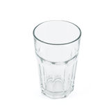 Drinking glass cup over white background. Faceted drinking empty glass cup isolated over white background Royalty Free Stock Images