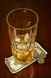 Drinking Glass With Tip Money Stock Image