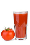 Drinking glass with tomato juice and tomato near Stock Images